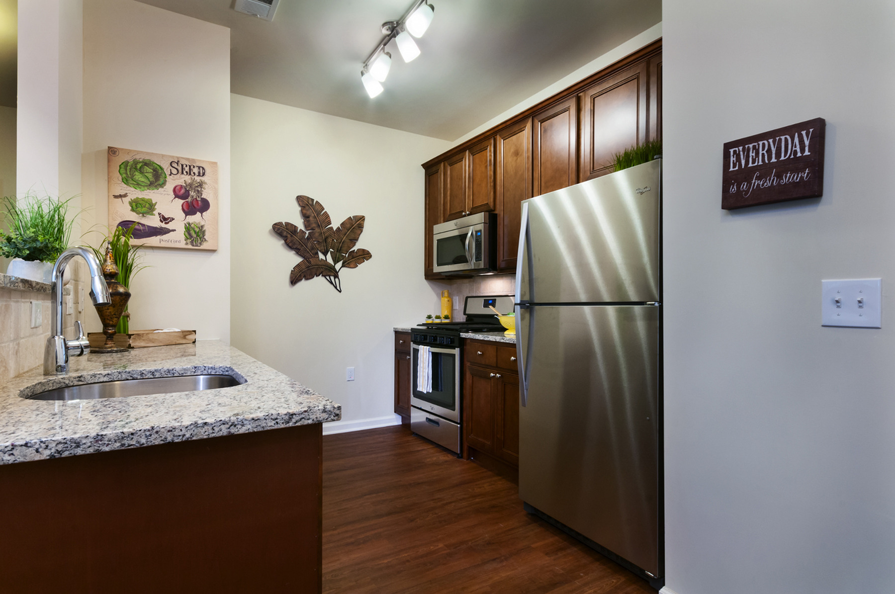 Gourmet Kitchens with Stainless, Granite, & Walnut Finishes