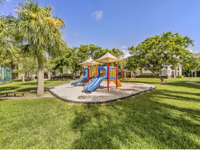 Colorful community playground and park area with bench