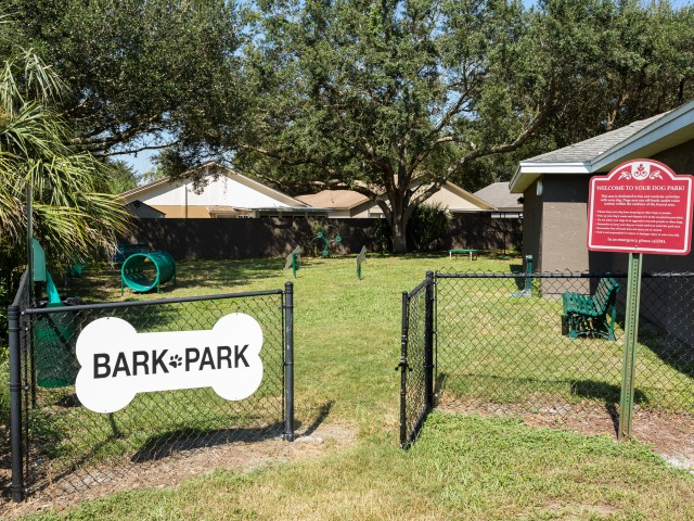 Alvista Sterling Palms Entrance to Bark Park with fenced in area and pet agility equipment