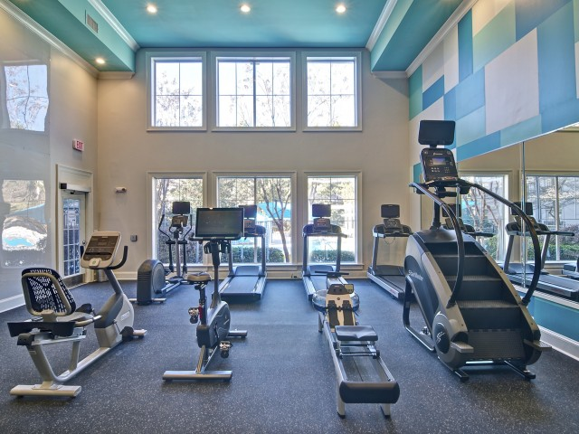 Large fitness center with treadmills, spin bikes and stairmaster