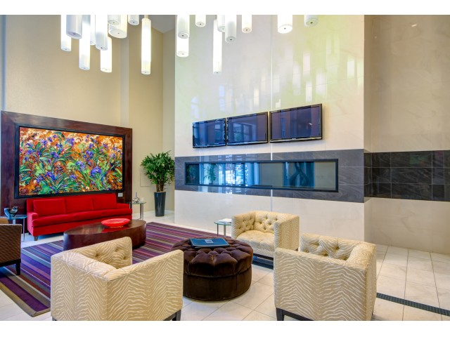 Twenty foot grand lobby with seating and fireplace