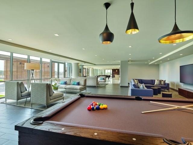 Billiard with pendant lighting.