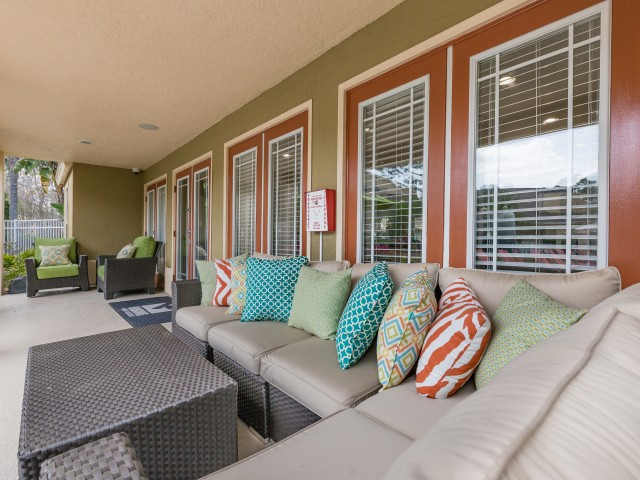 outdoor community covered seating with couch and table