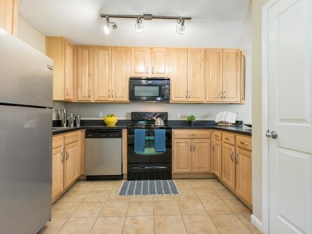 kitchen with refrigerator and wrap-around kitchen