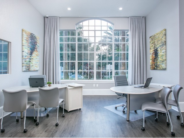 Alvista Metrowest Orlando Florida leasing office with two desk sets, large window and wood