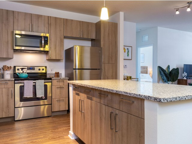m2 at millenia island kitchen with overabundance of cabinetry