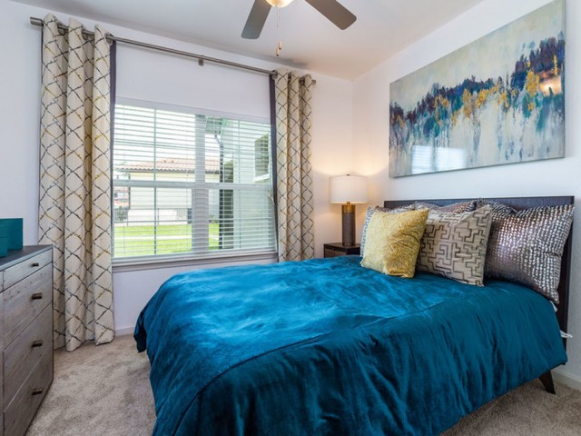 Treviso Grand Apartments - North Venice, Florida bedroom with ceiling fan and carpet