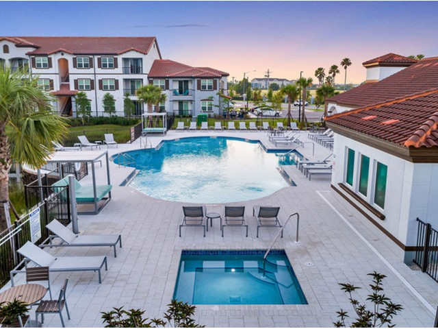Venetian Apartments Ft. Myers resort-style pool with daybeds and hot tub