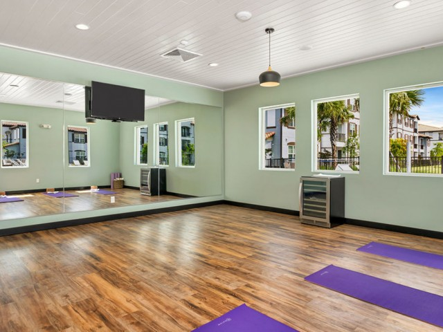 Venetian Apartments Ft. Myers yoga studio with television and water cooler