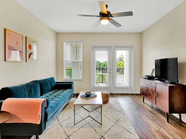 400 north apartments Maitland Florida living room with wood like vinyl flooring, ceiling fan with light, French doors to patio