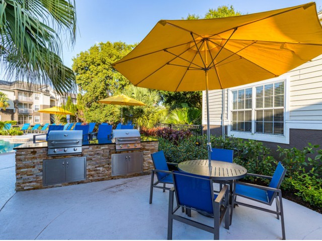 Alvista Sterling Palms outdoor deck by swimming pool with grilling area and seating