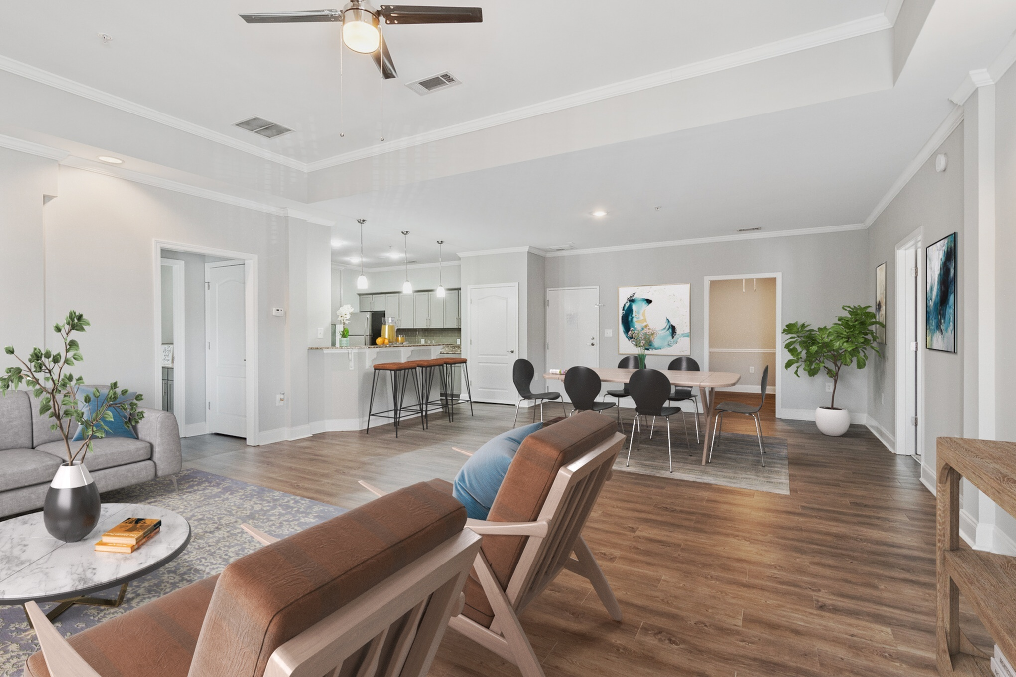 Living room with wood inspired plank flooring and large dining room area