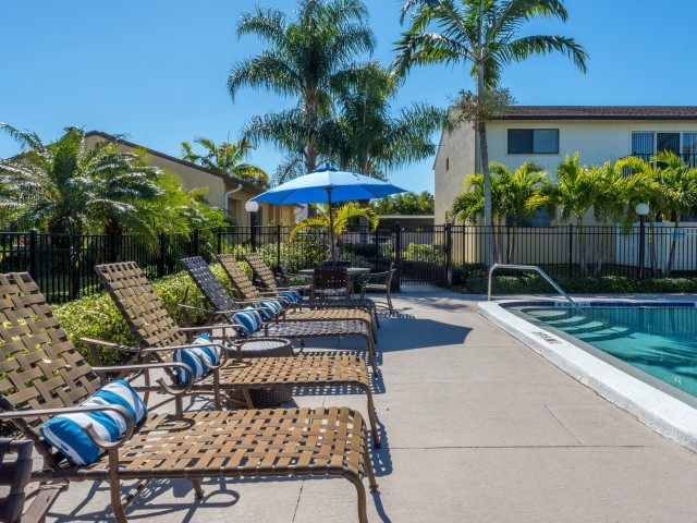 Harbour Pointe Apartments Indian Harbour Beach Florida pool area with lounge chairs with pillows