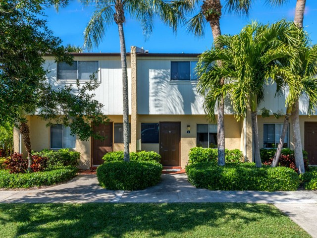Harbour Pointe Indian Harbour Beach Florida building exterior townhome with lush landscaping