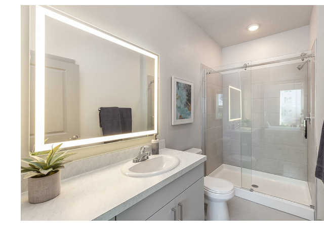 Madison Pointe Daytona Beach Florida bathroom with illuminated mirror