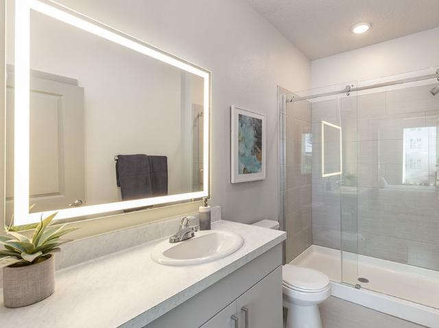 Madison Pointe Daytona Beach Florida bathroom with illuminated mirror