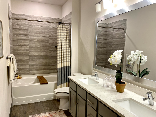 Bathroom with double vanities and large tub