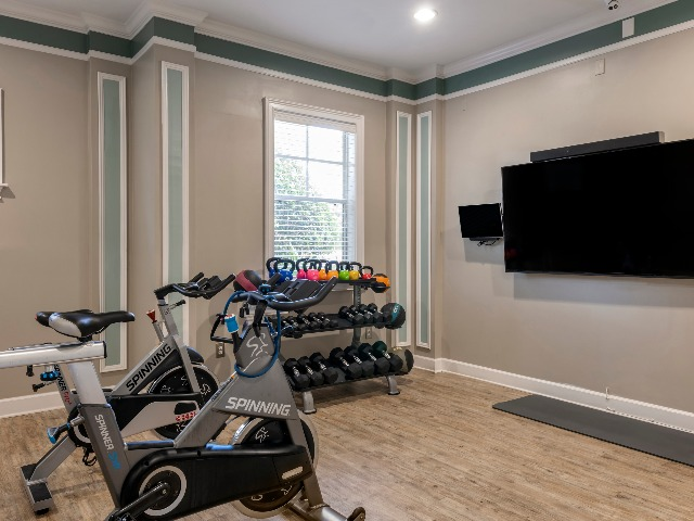 Legends at ChampionsGate Spin & Yoga Room with spin bikes and weighted sports equipment