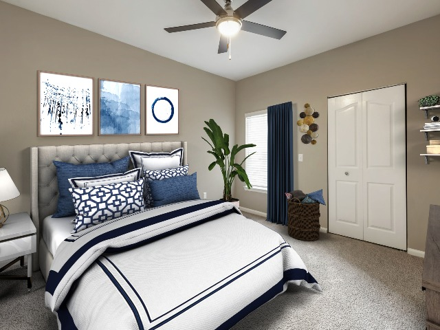Legends at ChampionsGate Plush Carpeting in Bedroom with Bed and Ceiling Fan