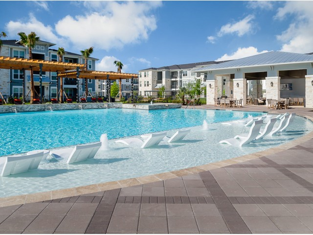 Image of Luxury lounge pool with in-water tanning deck for Boterra Bay