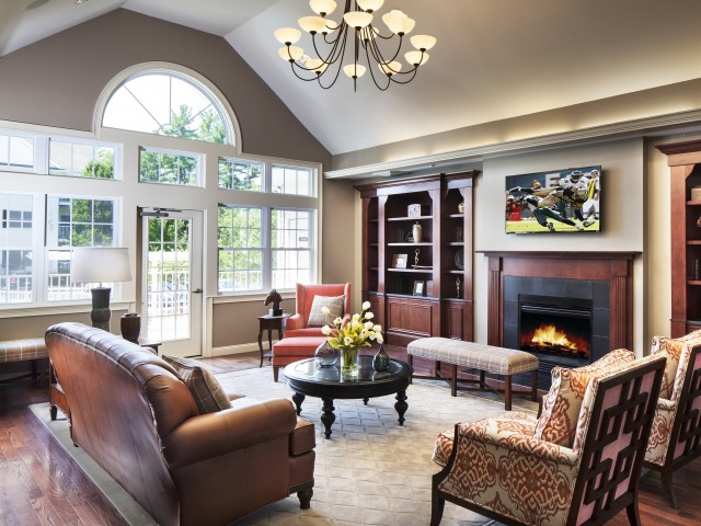 Image of Great Room with comfortable furnishings and fireplace for Heritage at Bedford Springs