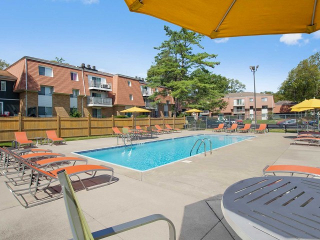 Tanning by the Pool | Apartments Milford MA | Rolling Green