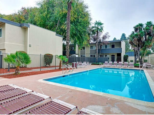 Trestles Apartments pool with chairs in San Jose, CA
