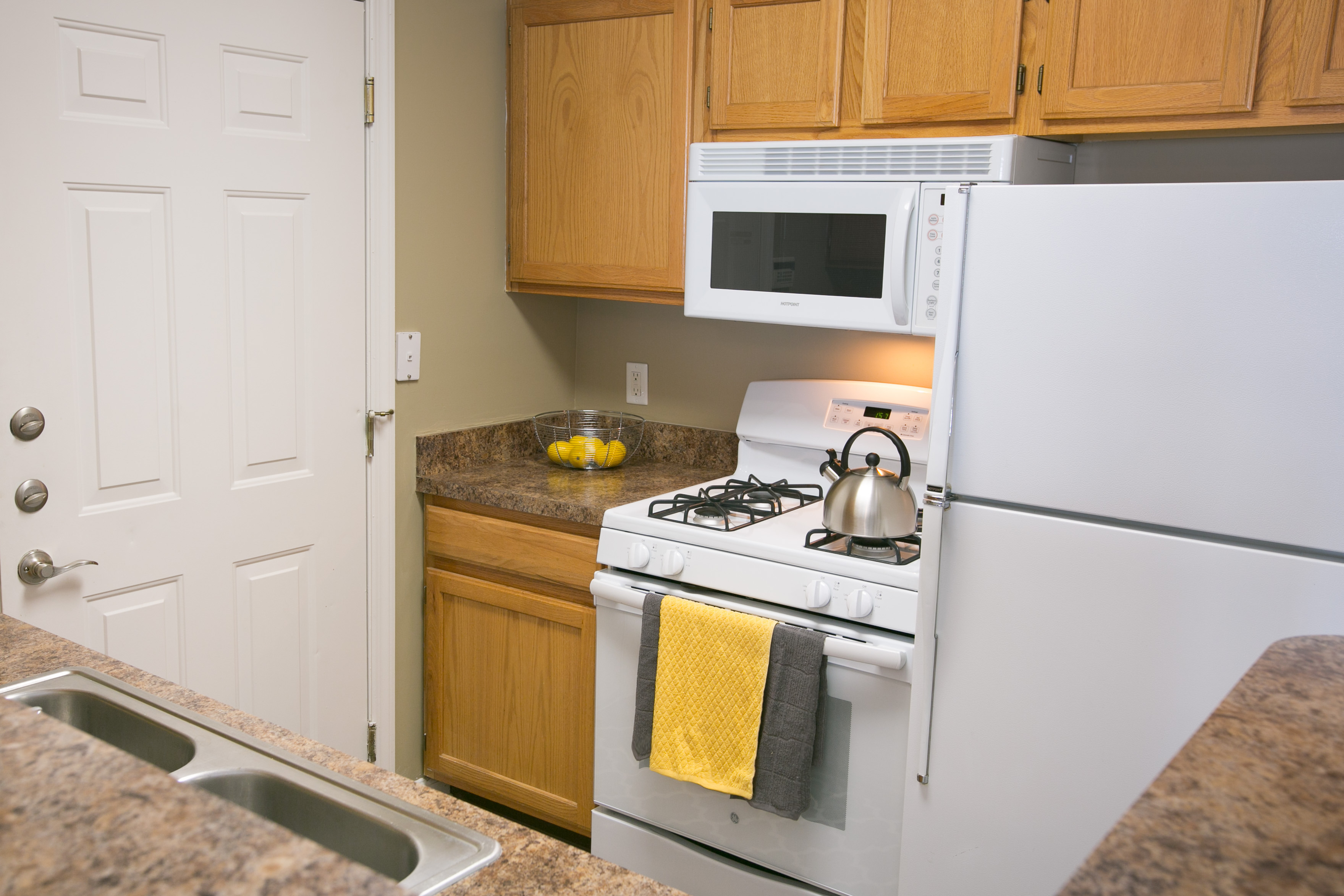 Updated counters and built in appliances at The Village of Western Reserve Apartments in Streetsboro, OH