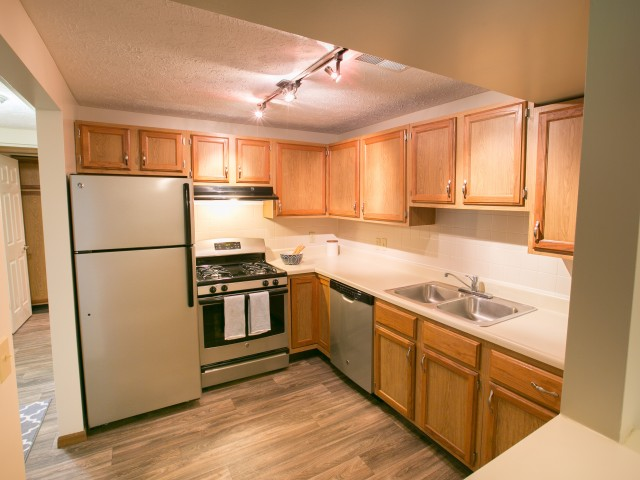 Upgraded kitchens with silver appliances and wood-style flooring available at Mallard\'s Crossing in Medina, Ohio