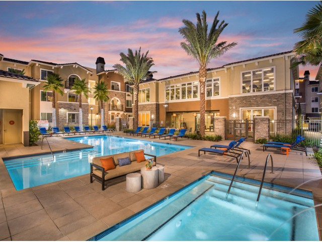Pool area at Valentia Apartments in La Habra, CA