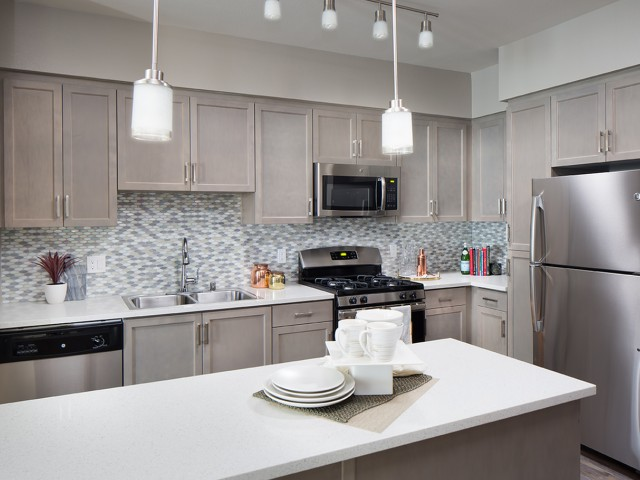 Image of Kitchen island with pendent lights and USB charging outlets* for Valentia Apartment Homes