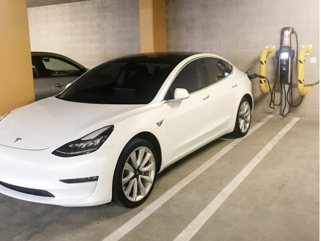 Image of Electric vehicle charging stations in parking garage for Areum Apartments
