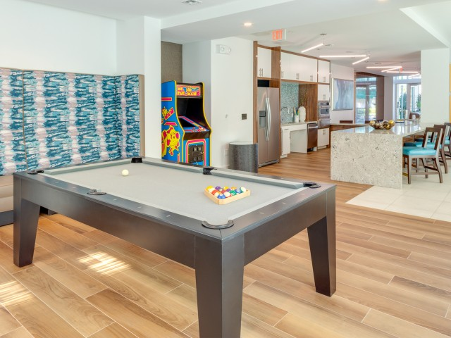 Game area at ORA Flagler Village Apartments in Fort Lauderdale Florida
