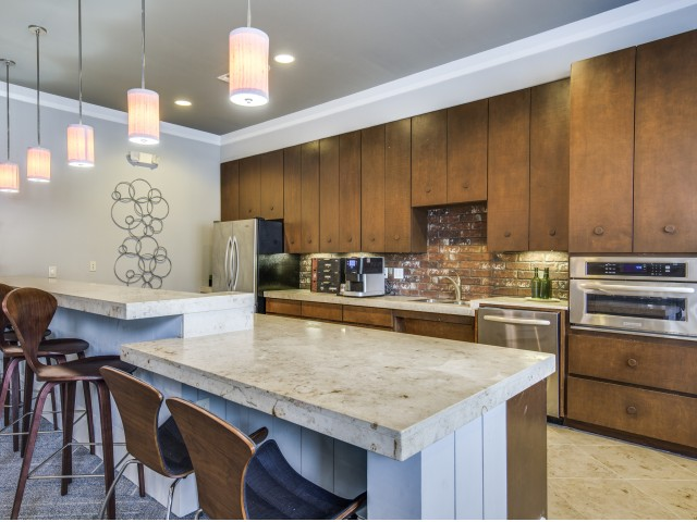 Clubhouse kitchen at Montfair at the Woodlands apartments in Houston TX