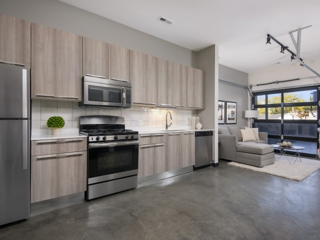 Kitchen With Stainless Steel Appliances, Quartz Countertops, Custom Italian  Cabinetry, And Track Lighting