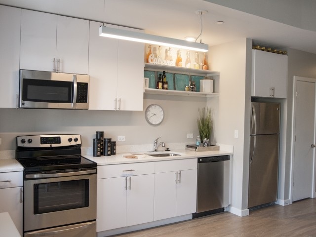 Image of Gourmet Kitchens with GE stainless steel ENERGY STAR® appliances for 500 Park Ave