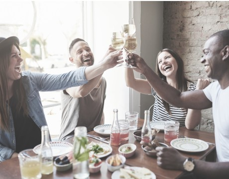 Group of people at a table clinking glasses
