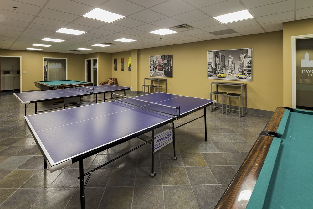 100 Midtown Apartments Game Room with Pool Tables and Ping Pong Tables