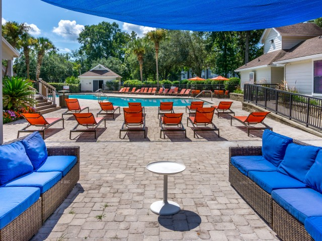 Covered lounge and lounge chairs by the pool at The Pavilion on 62nd