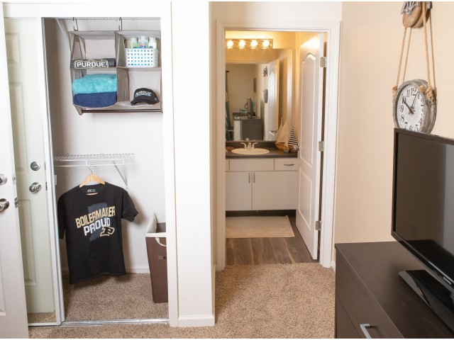 Bedroom with large closet and private bathroom at The Lodge on the Trail Apartments