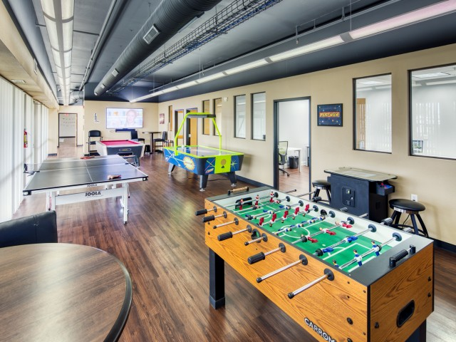 South Duff Apartments Game Room with foosball, pool table, air hockey, and more
