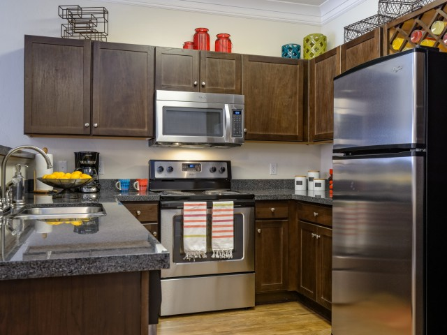 Image of Gourmet Kitchens w/ Stainless Steel Appliances for The Retreat at Tucson