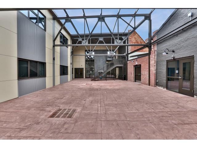 At Hudson Park Apartments, community courtyard, exposed beams, spacious