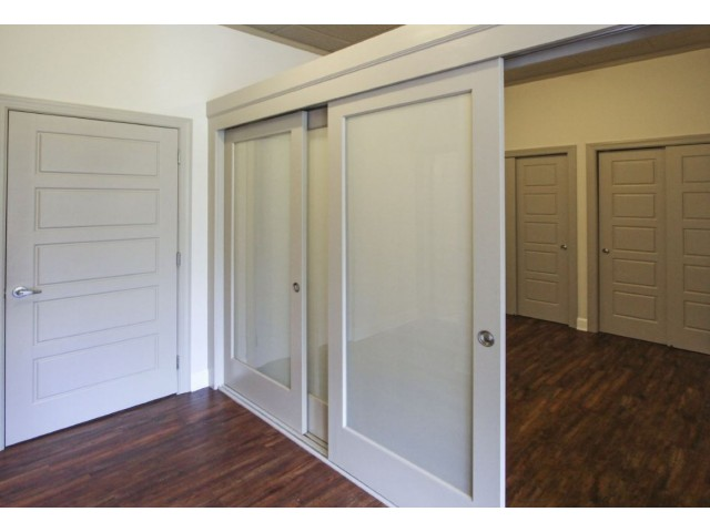 Image of Sliding glass wall partitions for Homeroom Lofts