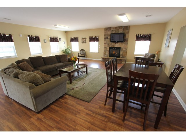 Long Pond Village Apartments, interior, spacious clubhouse, comfortable seating, dining for four, windows