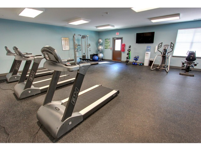 Carlton Hollow Apartments, interior, fitness center, treadmills, tv, weight machines, spacious