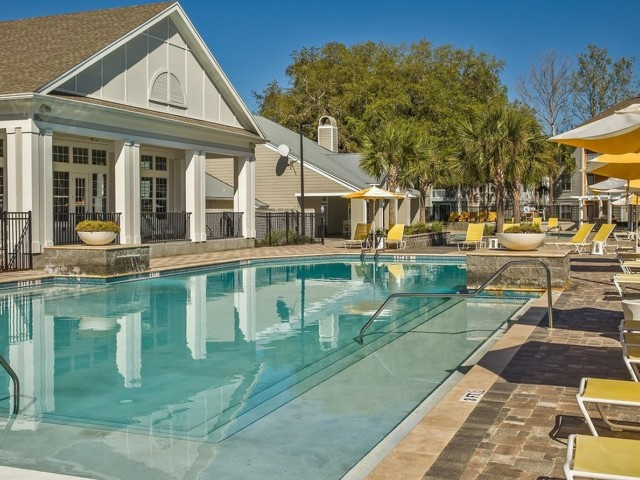 The Glenn-Exterior | Sparkling Swimming Pool with deck chairs