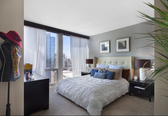 View of bedroom at Flair Tower Apartments in Chicago IL