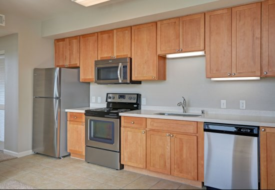 View of model kitchen at Villa Montanaro Apartments in Pleasant Hill CA