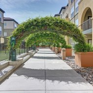 View of walkway at Villa Montanaro Apartments in Pleasant Hill CA